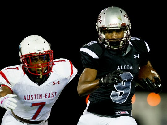 Alcoa's DiAndre Johnson (9) runs the ball as Austin-East's Robert Allen (7) pursues during a game between Austin-East and Alcoa at Alcoa High School in Alcoa, Tennessee on Friday, October 27, 2017.