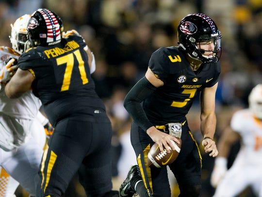 Missouri quarterback Drew Lock (3) looks to pass