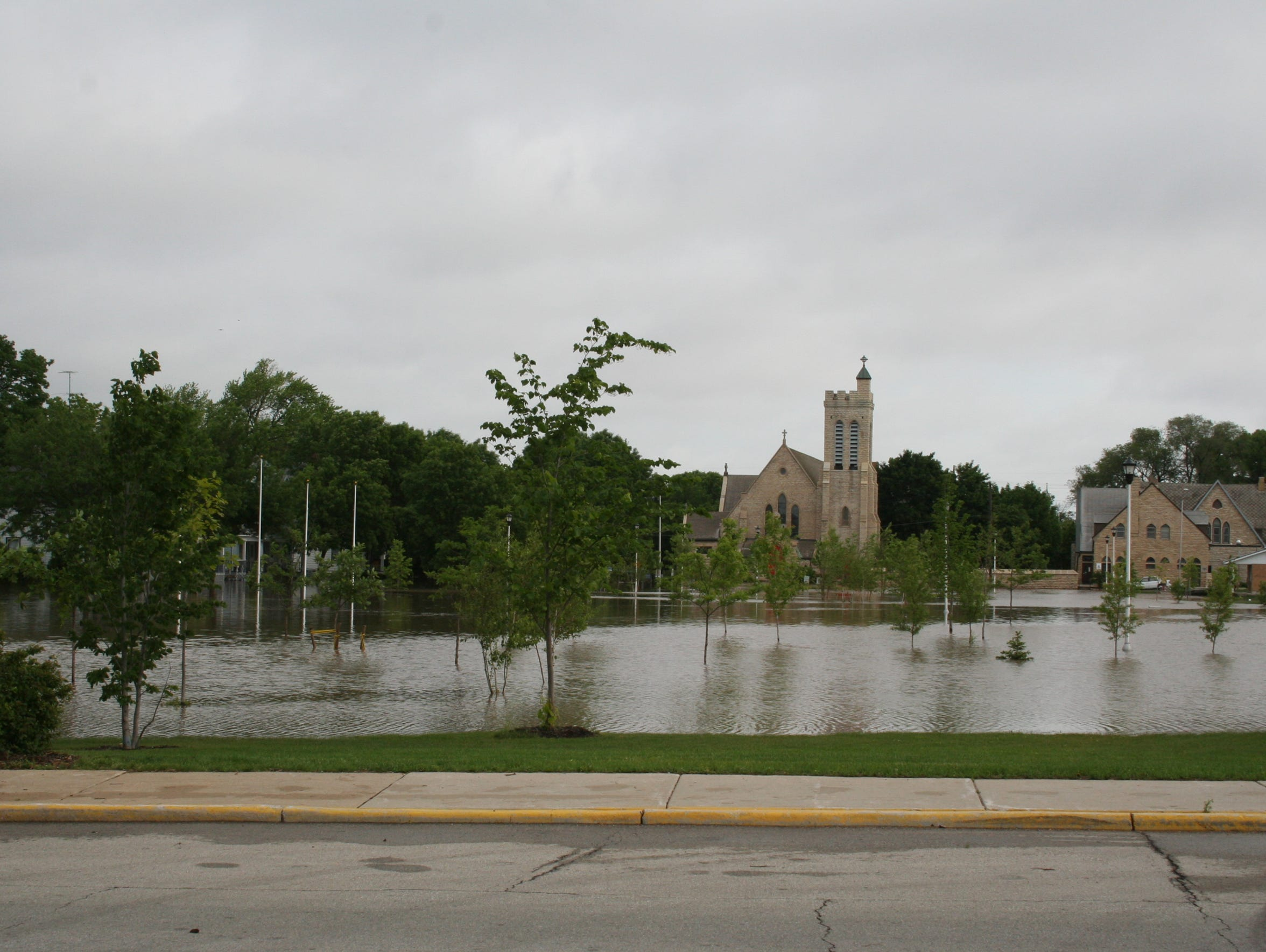 Flood waters fill Hamilton Park between Division Street