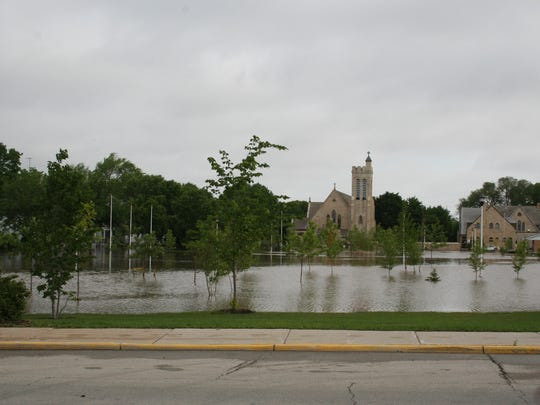 Flood waters fill Hamilton Park between Division Street and Forest Avenue.