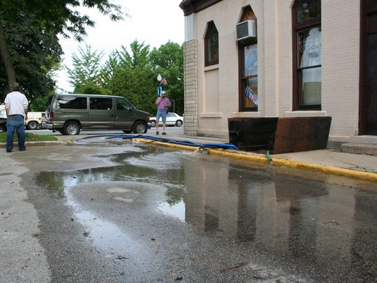 Water is pumped out of the basement of Beernuts, 183 S. Main St.