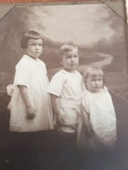 Margaret (Calkins) Gordon, at far right as a child.