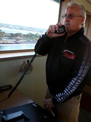 Capt. Bob Thibaudeau calls distances to members of
