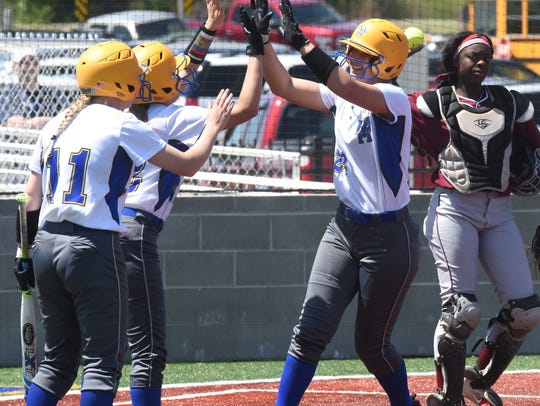 Mountain Home's Maly Tabor is congratulated by teammates