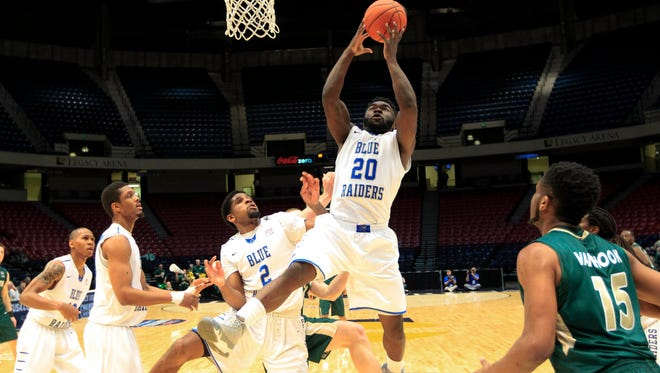 Middle Tennessee guard Giddy Potts (20) grabs a rebound during a game against Charlotte on Thursday during the Conference USA Tournament.