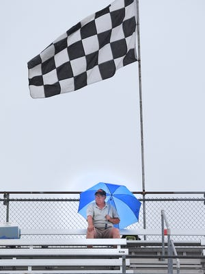 The smart fans brought umbrellas to qualification day for the 99th Indianapolis 500 Saturday, May 16, 2015, morning at the Indianapolis Motor Speedway.