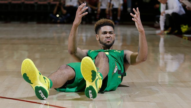 Oregon's Tyler Dorsey (5) reacts after hitting the ground during the first half of an NCAA college basketball game against Stanford in Stanford, Calif., Saturday, Feb. 13, 2016. Stanford won 76-72.
