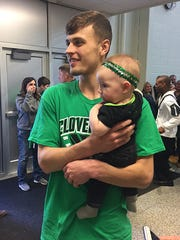 Cooper Neese holds Sadie Rempe after Cloverdale's season-ending