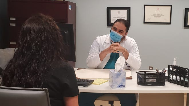 Dr. Leonardo Batista of Morton Hospital, in his office.
