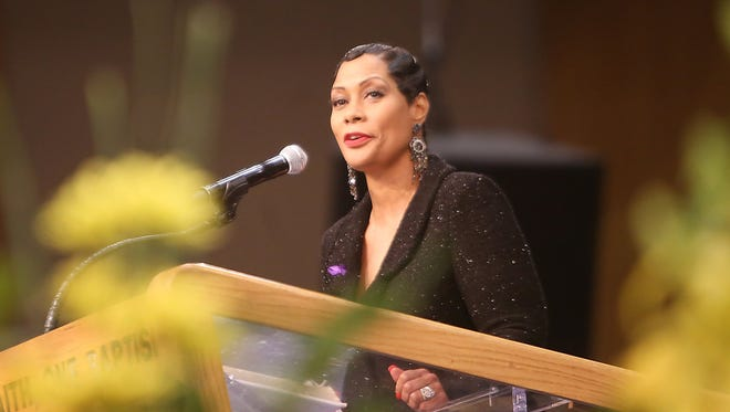 Monica Morgan-Holiefield, wife of General Holiefield speaks during the funeral service at  Greater Grace Temple in Detroit in 2015.