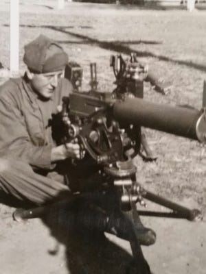 Kirkpatrick was a was a recoilless rifle gunner in the army. He is pictured here with a .30-caliber machine gun.