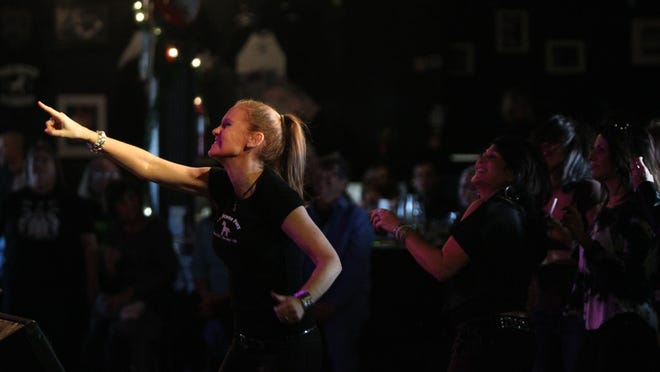 Amy Decker reacts to performance by the EddieTesta Band during the Light of Day show at the Stone Pony in Asbury Park on Sunday, Jan. 11, 2015.