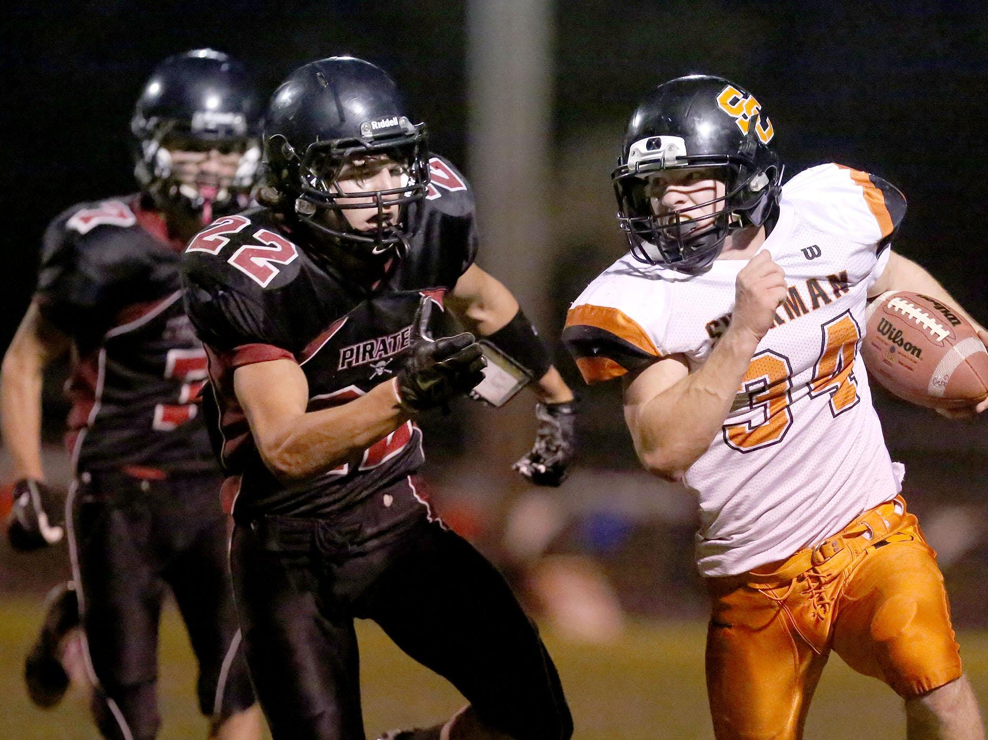 Perrydale's Brant Barnes (22) chases down Sherman junior Maverick Winslow (34) during their football game on Friday, Oct. 23, 2015, in Perrydale, Ore.