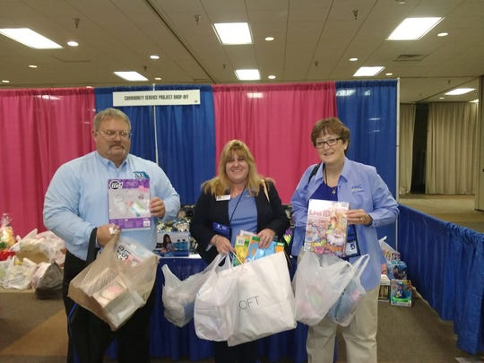 Paul Horton, Lynne O'Dell and Gail Sheets deliver holiday gift donations on behalf of the Indian River State College AFC chapter.