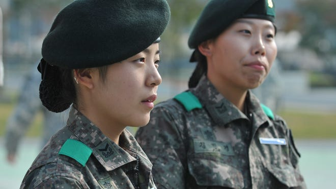 Staff Sgts. Kwon Min Zy, left, and Kim Min Kyoung earned the U.S. Army's Expert Infantryman Badge on Oct. 23, 2014, at Camp Casey, South Korea.