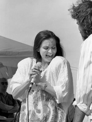 Crystal Gayle and Gary Morris are performing together in the Warner Bros. Records show during Fan Fair at the State Fairgrounds June 11, 1986.