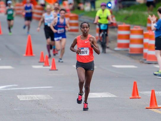 Bizuwork Kasaye runs down Pine Street during the Vermont