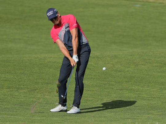 Henrik Stenson, of Sweden, hits on the 13th fairway during the third round of the U.S. Open Golf Championship, Saturday, June 16, 2018, in Southampton, N.Y. (AP Photo/Frank Franklin II)
