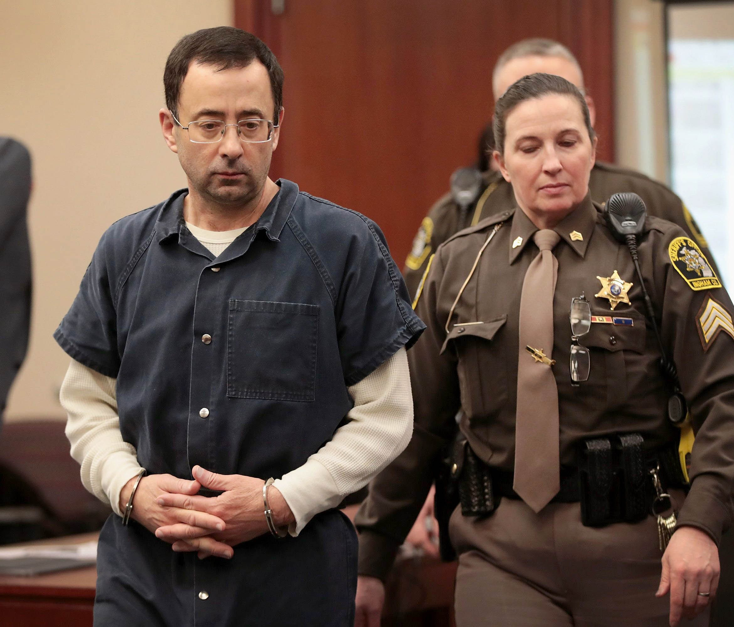 Larry Nassar appears in court on to listen to victim-impact statements prior to being sentenced on January 16, 2018 in Lansing.