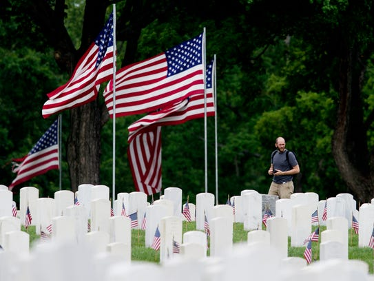 A man walks through the Knoxville National Cemetery