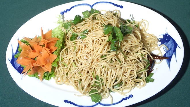 Spicy cold noodle salad prepared by Chef Jeff Wang  at Sampan restaurant in Phoenix.