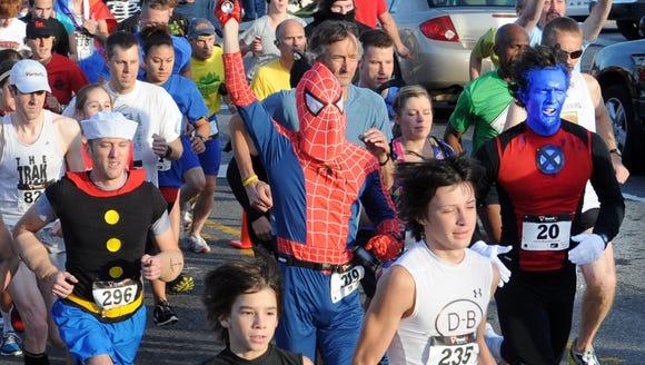 Runners take part in the Super Hero 5K in Asheville.
