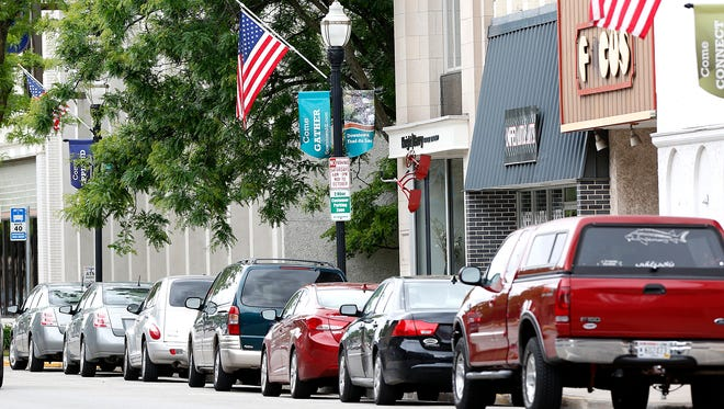 Cars fill all the parking stalls in a two-hour parking zone on Main Street in downtown Fond du Lac. Some business owners are complaining there are no spots for customers because employees and people living downtown are taking up the spots.