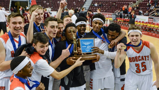 The Northeastern Bobcats celebrate the program's first district title after defeating Mechanicsburg in the District 3 Class 5-A basketball championship, Friday, March 3, 2017. John A. Pavoncello photo