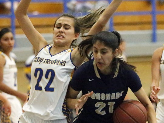 Eastwood's Kaylee Martinez, 22, tries putting a stop
