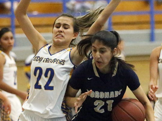 Eastwood's Kaylee Martinez, 22, tries putting a stop to a drive by Coronado's Nehaa Sohail last season.