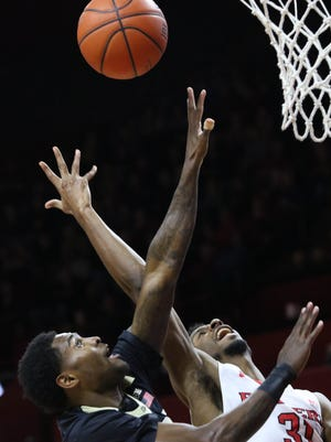 Rutgers' Omar Grier is defended by Purdue's Johnny Hill as he goes up for a basket.