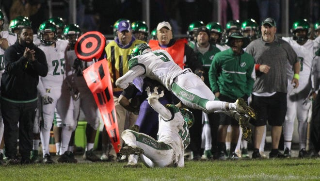 Northmont's Jestin Jacobs makes a tackle against Pickerington Central on Friday, Nov. 3, 2017, in Pickerington.