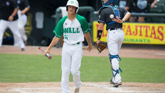 Wall's Caleb Heuertz walks back to the dugout after striking out ending the second inning of the 3A State Final at Dell Diamond in Round Rock on Thursday, June 8, 2017.