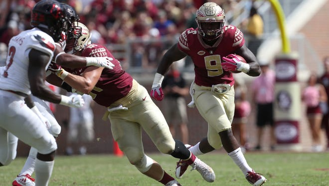 FSU's Jacques Patrick runs the ball against Louisville during their game at Doak Campbell Stadium on Saturday, Oct. 21, 2017.