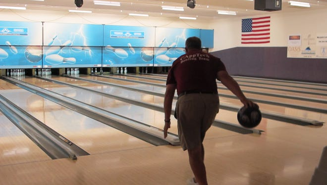 A man prepares to launch a ball for a strike at the Virgin River Casino Bowling Center.