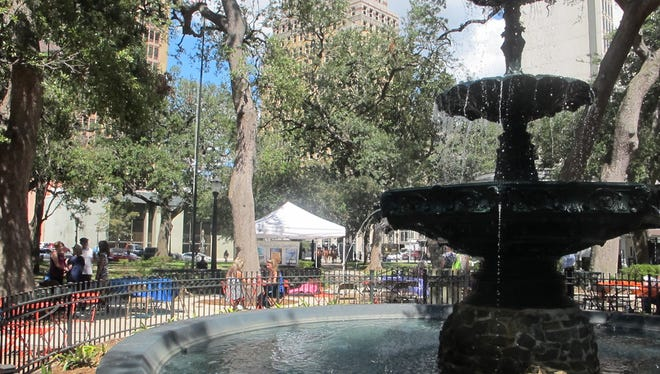 In this Wednesday, Sept. 16, 2015, photo, a fountain is seen in Bienville Square as people gather for a noontime concert, in downtown Mobile, Ala. Antebellum architecture, pre-Civil War Spanish and French forts, a rich history as a vibrant sea port and an emerging art and music scene make Mobile a great destination for tourists wanting to experience Southern culture and history. (AP Photo/Melissa R. Nelson)