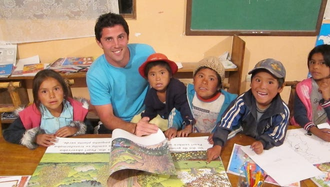 "Gareth Leonard, of Rochester, shares a photo he describes as ""the best part about volunteering to help build libraries in the Chuquisaca region of Bolivia."""