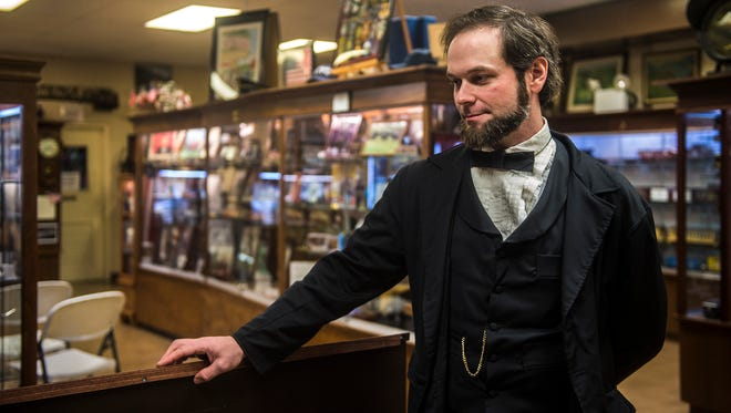 Lincoln re-enactor Rich Neely takes part in a conversation about the life of General Grant during a few moments of downtime in between museum visitors on Feb. 14, 2016.