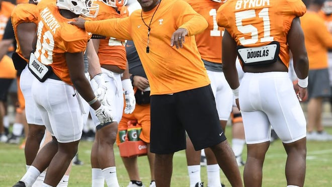 University of Tennessee linebackers coach Tommy Thigpen instructs players DaJour Maddox (48) and Kenny Bynum (51) during practice at Haslam Field Tuesday, Aug. 11, 2015. (AMY SMOTHERMAN BURGESS/NEWS SENTINEL)