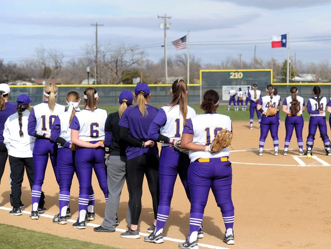 The Hardin-Simmons softball team stands for the National