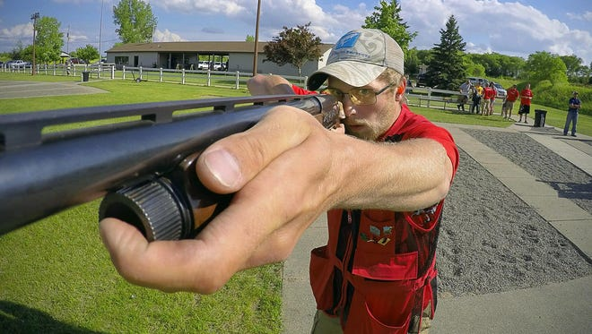 Monticello High School Trap Shooting Team member Luke Swanson shoots at a flying clay target during practice in June at the Monticello Sportsmen Club in preparation for the 2015 state meet.