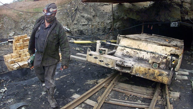 Miner Dan Campbell of Closplint, in Harlan County, exits the Manalapan Mining Co. Mine No. 19 in 2000.