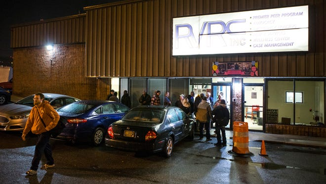 People line up outside of the Rick VanStory Resource Center in Wilmington on Wednesday night.