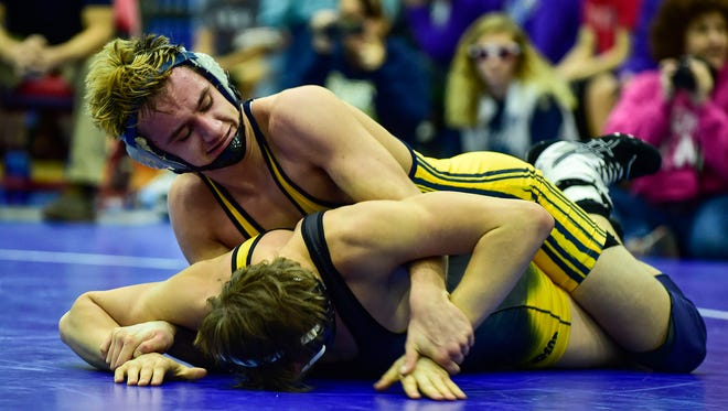 River Valley's Bryce Hessler keeps the dominant position over Northmor's Matthew Ross during the 152-pound finals at the MOAC Wrestling Championships at Highland High School on Saturday.