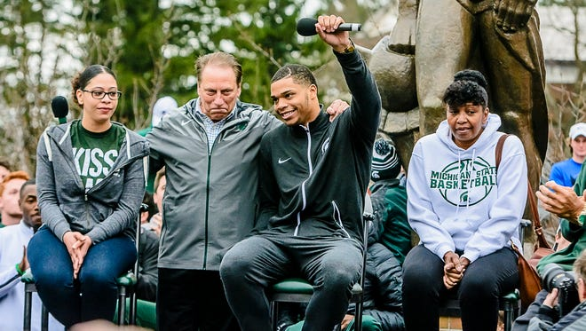 MSU freshman men's basketball player Miles Bridges waves to the crowd at a press conference at the Sparty statue where he announced his decision to remain in school next season.