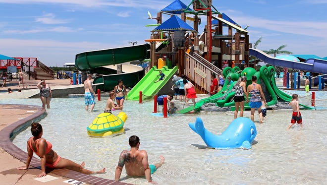 Dozens of children and parents lounge and play in the Buccaneer Bay at Castaway Cove Waterpark at the beginning of the 2017 season.