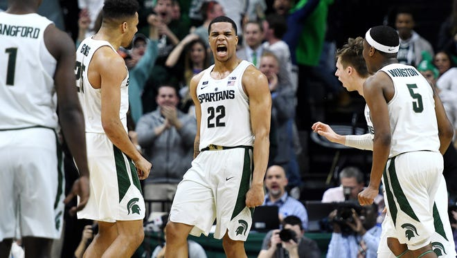 Michigan State's Miles Bridges, center, celebrates after making a 3-pointer to put the Spartans ahead with two seconds remaining during the second half on Saturday, Feb. 10, 2018, at the Breslin Center in East Lansing. The Spartans beat Purdue 68-65.