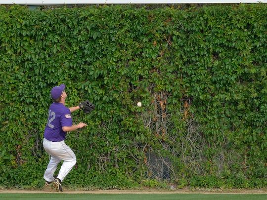 Little Falls' Drew Bulson (12) watches as the ball