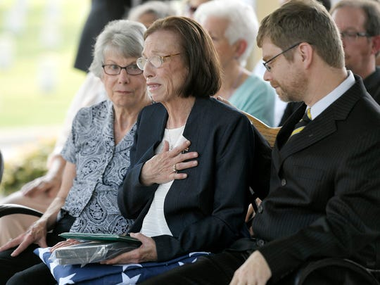Linda Tinsley, center, of Murfreesboro becomes emotional