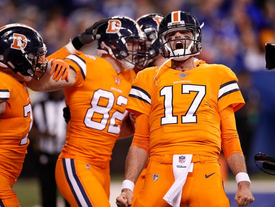 Denver Broncos quarterback Brock Osweiler (17) celebrates
